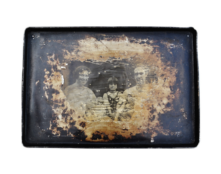 """Decaying Family Picture"" from the Baking Pan Series, 2000, Liquid Silver Emulsion on Metal"